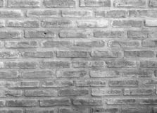 White and gray brick wall background in coffee cafe at rural room. Beautiful color of wallpaper building royalty free stock image