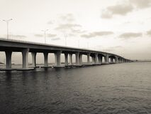 White and Gray Bridge on Body of Water Stock Images