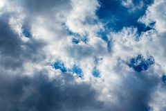 White and gray clouds against blue sky. Coulds start to form a storm in sunny day. White and gray clouds against blue sky. Coulds start to form a storm in sunny stock images