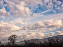 White and gray clouds in a blue sky with foreground Royalty Free Stock Image