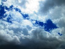 blue arrow  with gray and white clouds in the sky  Stock Image