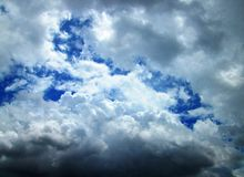 White and gray clouds in blue sky Stock Images