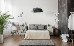 White and gray cozy bedroom. Interior of white and gray cozy bedroom Royalty Free Stock Images