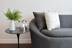 White and gray decorative pillow on a casual sofa Stock Photos