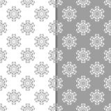 White and gray floral backgrounds. Set of seamless patterns Stock Images