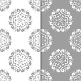 White and gray floral backgrounds. Set of seamless patterns Royalty Free Stock Photos