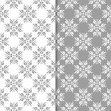 White and gray floral ornaments. Set of seamless backgrounds. For textile and wallpapers Royalty Free Stock Photo