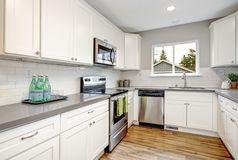 White and gray kitchen room with modern appliances. stock photos