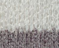 White and gray knit material - up close abstract background Royalty Free Stock Photo