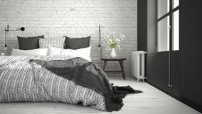 White and gray modern bedroom with cozy double bed, brick wall, Royalty Free Stock Image