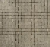 White gray mosaic pattern on a wall Stock Photo