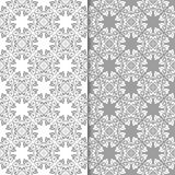 White and gray set of floral seamless patterns. White and gray set of floral backgrounds. Seamless patterns for textile and wallpapers Royalty Free Stock Photos