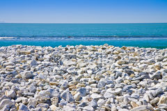 White and gray stones softly rounded against a blue sky.  Royalty Free Stock Images