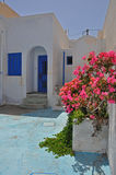 White greek bungalow with pink flowers Royalty Free Stock Photography