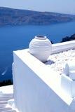 White greek pot on white terrace, Oia, Santorini, Cyclades, Gree Stock Image