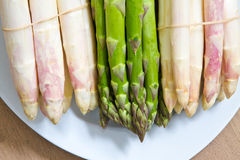 White and green asparagus Stock Photos