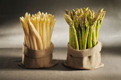 White and green asparagus in cloth bags. On canvas background royalty free stock photo