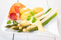 White and green asparagus with prosciutto Royalty Free Stock Image