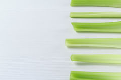 White and green background picture with raw Celery stems royalty free stock photography