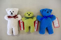 Trauma teddies hand made in Red Cross Australia stock images