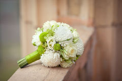 White and green bouquet on a stone parapet Royalty Free Stock Photo