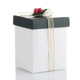 White and green box with gold bow Royalty Free Stock Image