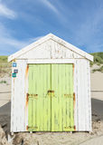 White Green Cabin on the Beach Stock Images