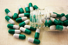 White- green capsules Stock Images