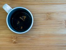 Ceramic cup on wood royalty free stock image