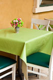 White and green chair with table Stock Images