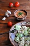 White and green dumplings with sauce stock photography