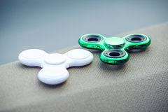 White and green fidget spinner relieving toy. Trends in children's anti-stress toys. White and green fidget spinner stress relieving toy. Trends in children's Stock Photography
