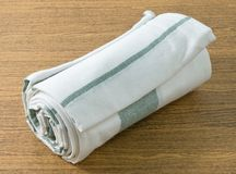 White and Green Kitchen Towel on Wooden Table Stock Photography