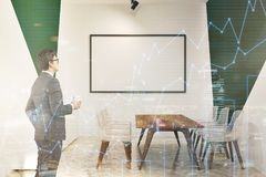 White and green meeting room, whiteboard, man. White and green wall modern office conference room interior with a long table, transparent chairs, and a Royalty Free Stock Photography