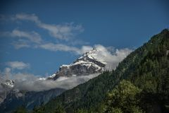 White and Green Mountain Under White Clouds Stock Images