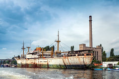 White and green old rusted ship stands moored Stock Photo