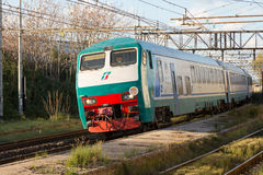 White and Green Passenger Train. I shoot this in Pisa, Italy Stock Photography