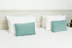 White and green pillows on bed Royalty Free Stock Images