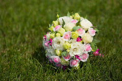 White green, pink and yellow and pink wedding bouquet with roses on the grass. Colorful image of beautiful nosegay Royalty Free Stock Photo