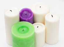 White, green, purple candles  on white. Royalty Free Stock Image