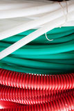 White, green and red cable hoses Royalty Free Stock Photo