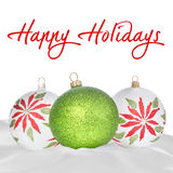 White, Green and Red Christmas Ornaments On White. Background ~ Copy space for Greeting Stock Photo