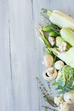 White and green vegetables on the blue wooden board. Royalty Free Stock Photo