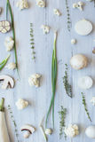 White and green vegetables on the blue wooden board top view. Stock Photo