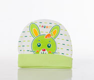 A white and green winter baby hat Royalty Free Stock Photography