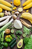 White, green, yellow fruits and vegetables on wooden background. Healthy food. Multicolored raw food stock photos