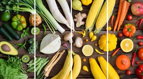 White, green, yellow, orange, red fruits and vegetables on wooden background.  Healthy food. Multicolored raw food royalty free stock photography