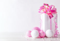 White greeting card with copy space for christmas or new year with a wrapped gift and pink ball Stock Photos