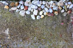 White, grey and brown stones background on concrete. Abstract background with stones on cement. royalty free stock image