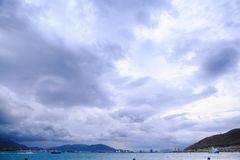 White Grey Clouds over Sea Distant Resort City Boats Stock Photography